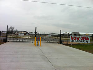 Gated entrance to the River Cities RV Park in Boyce, LA